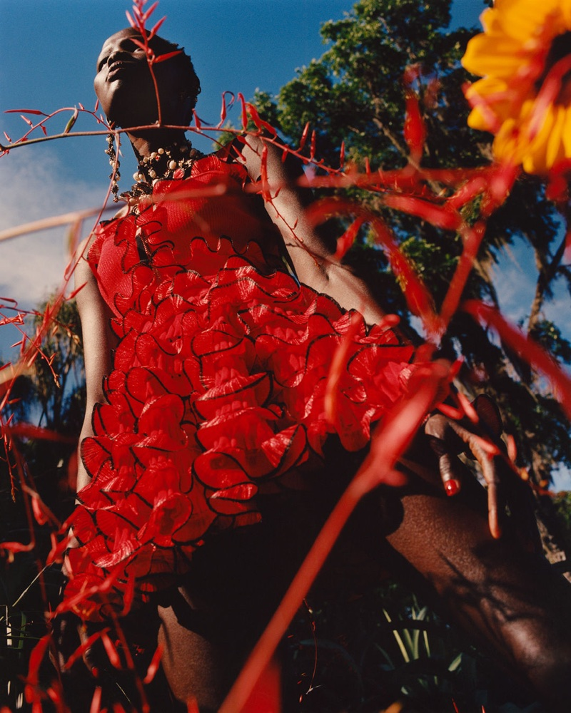 Model Shanelle Nyasiase poses in red dress for Alexander McQueen's spring-summer 2018 campaign