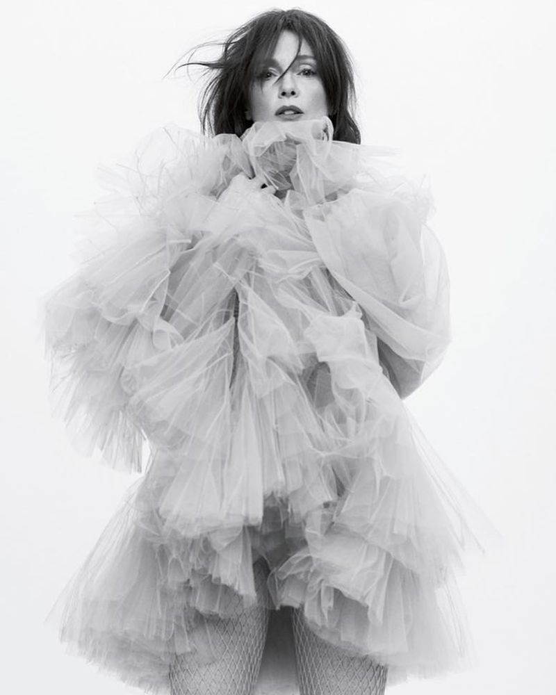Actress Julianne Moore poses in Dior dress and tights